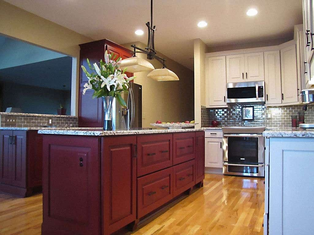 kitchen island built of raised-panel painted garnet cabinets with furniture feet